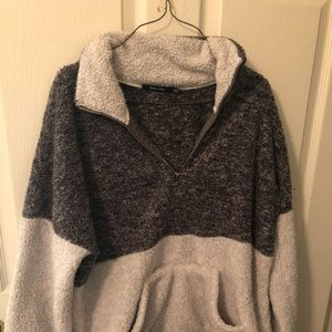 White and grey pull over